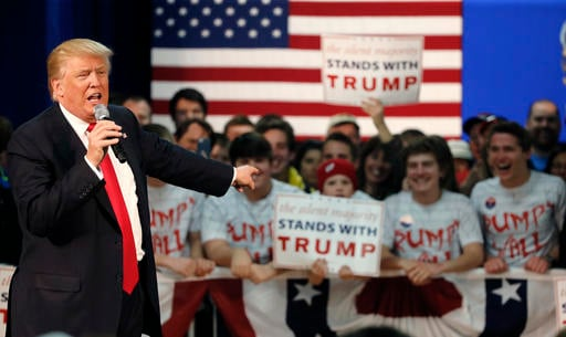 (AP Photo/Charles Rex Arbogast). Republican presidential candidate, Donald Trump, acknowledges the young people behind him at a town hall Saturday, April 2, 2016, in Rothschild, Wis.