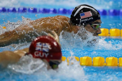 (AP Photo/Rebecca Blackwell). United States' Michael Phelps and Britain's James Guy compete in the men's 4 x 100-meter medley relay final during the swimming competitions at the 2016 Summer Olympics, Saturday, Aug. 13, 2016, in Rio de Janeiro, Brazil.