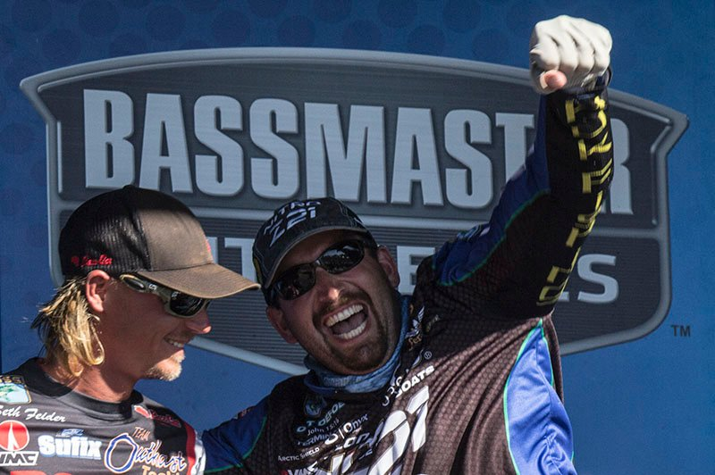 Ott DeFoe reacts when his weigh-in is announced that gave him the win in the Bassmaster tournament in La Crosse. He's standing next to Seth Feider, who finished second.