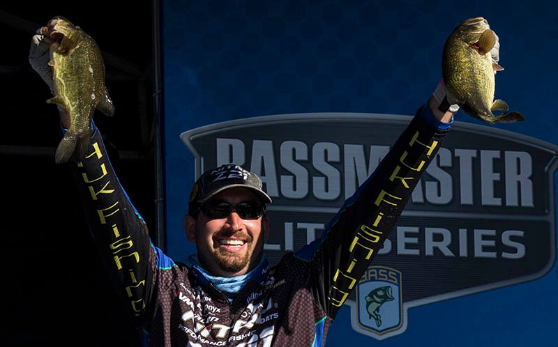 Ott DeFoe holds up two of his five fish from Sunday that helped give him the win.