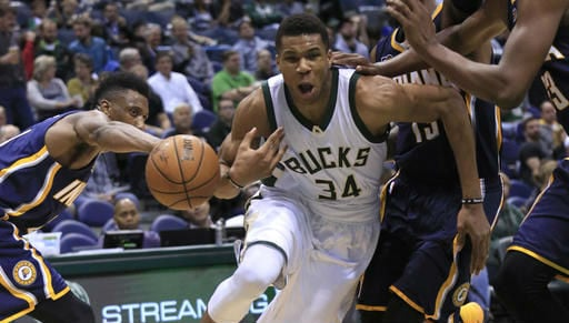 (AP Photo/Darren Hauck). Milwaukee Bucks forward Giannis Antetokounmpo, center, loses the ball on a drive against the Indiana Pacers during the second half of an NBA preseason basketball game Wednesday, Oct. 19, 2016