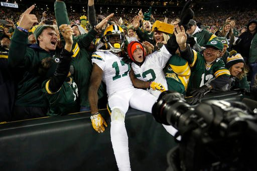 Green Bay Packers wide receiver Davante Adams (17) celebrates a touchdown with fans during the second half of an NFL football game against the Chicago Bears, Thursday, Oct. 20, 2016, in Green Bay, Wis.