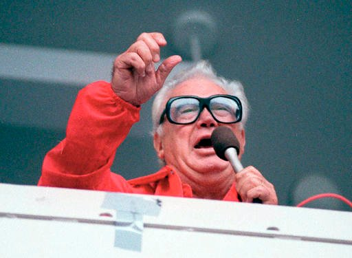 "(AP Photo/John Swart, File). FILE - In this July 21, 1989 file photo Chicago Cubs' broadcaster Harry Caray sings ""Take Me Out To The Ballgame"" during the seventh inning stretch at Chicago's Wrigley Field."