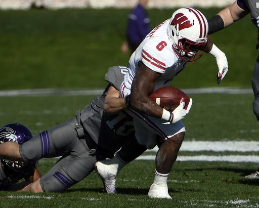 Wisconsin running back Corey Clement (6) is tackled by Northwestern linebacker Brett Walsh (10) during the first half of an NCAA college football game in Evanston, Ill., Saturday, Nov. 5, 2016