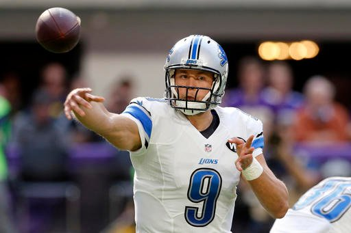 Detroit Lions quarterback Matthew Stafford throws a pass during the first half of an NFL football game against the Minnesota Vikings, Sunday, Nov. 6, 2016, in Minneapolis.