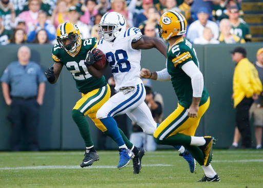 Indianapolis Colts' Jordan Todman (28) runs back the opening kickoff for a touchdown during the first half of an NFL football game against the Green Bay Packers Sunday, Nov. 6, 2016, in Green Bay, Wis.