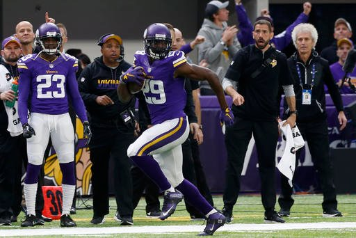 Minnesota Vikings wide receiver Cordarrelle Patterson, right, runs from Arizona Cardinals outside linebacker Deone Bucannon (20) after making a reception during the first half of an NFL football game, Sunday, Nov. 20, 2016, in Minneapolis.
