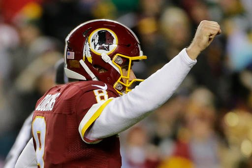 Washington Redskins quarterback Kirk Cousins (8) celebrates running back Rob Kelley's touchdown during the first half of an NFL football game against the Green Bay Packers in Landover, Md., Sunday, Nov. 20, 2016.
