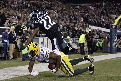 Green Bay Packers' Trevor Davis (11) scores a touchdown against Philadelphia Eagles' Nolan Carroll (22) during the first half of an NFL football game, Monday, Nov. 28, 2016, in Philadelphia.
