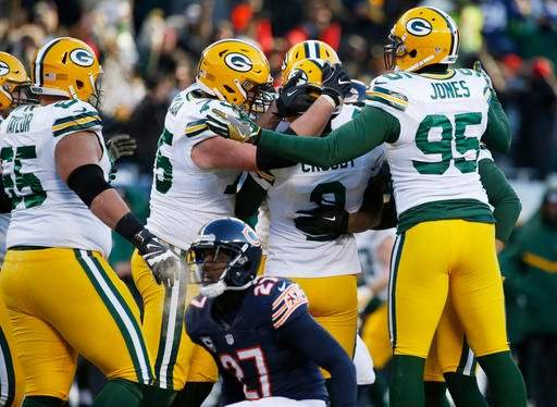 Green Bay Packers kicker Mason Crosby (2) celebrates with his teammates after kicking a game winning field goal against the Chicago Bears during the second half of an NFL football game, Sunday, Dec. 18, 2016, in Chicago.