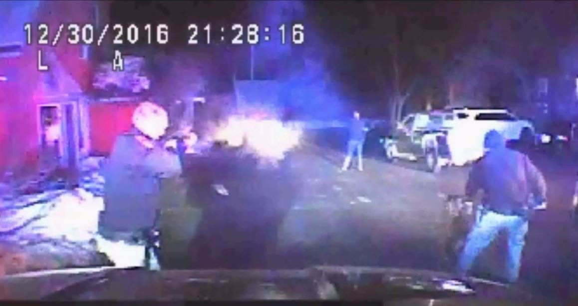 La Crosse Police Officer Ryan Deflorian fires non-lethal bean bag rounds in at suspect Daniel Lexvold on December 30, 2016.