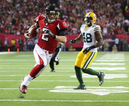 Atlanta Falcons' Matt Ryan runs for a touchdown during the first half of the NFL football NFC championship game against the Green Bay Packers, Sunday, Jan. 22, 2017, in Atlanta.