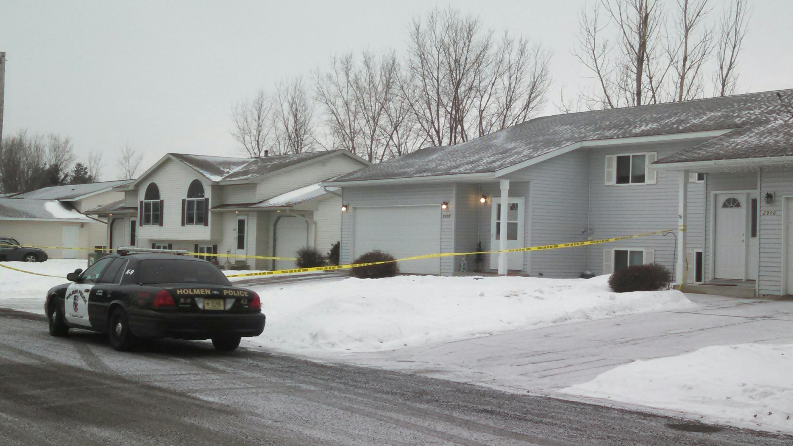 Photo from March 2, 1015 as a Holmen Police car sits outside the home where the homicide took place.