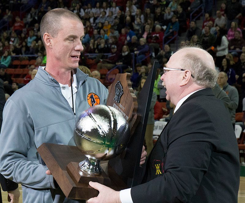 Coach Dave Donarski receives the Runner Up trophy from Ted Knutson.