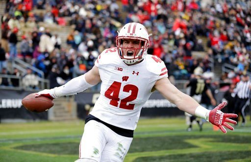(AP Photo/Michael Conroy, File). FILE - This Nov. 19, 2016, file photo shows Wisconsin linebacker T.J. Watt (42) celebrating after returning an interception for a touchdown during the first half of an NCAA college football game against the Purdue