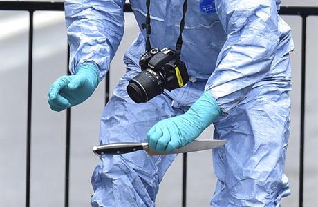 Woman under armed guard in London following anti-terrorism raid
