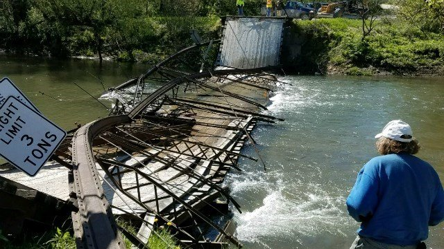 Global Positioning System  takes semi over bridge, collapsing bridge