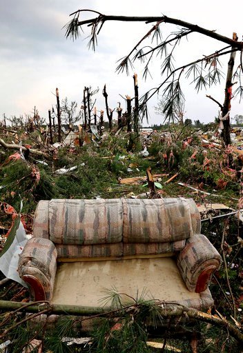(Dan Reiland/The Eau Claire Leader-Telegram via AP). A sofa sits on damaged trees after a tornado ripped through Prairie Lake Estates trailer home park, just north of Chetek, Wis., Tuesday, May 16, 2017.
