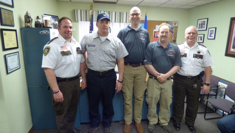 Winona County Chief Deputy Jeff Mueller, Dakota Firefighters Matt Nelson and John Smith, and Sheriff Ron Ganrude