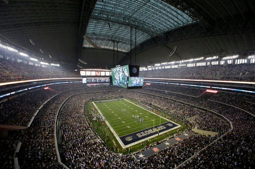 (AP Photo/Tony Gutierrez, File). FILE - In this Sept. 8, 2013, file photo, fans watch at the start of an NFL football game between the New York Giants and Dallas Cowboys, in Arlington, Texas.