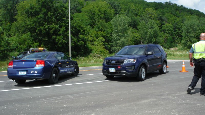 BCA investigators near the interstection of Highway 16 and 26 where they are gathering evidence in the officer involved shooting earlier Monday.