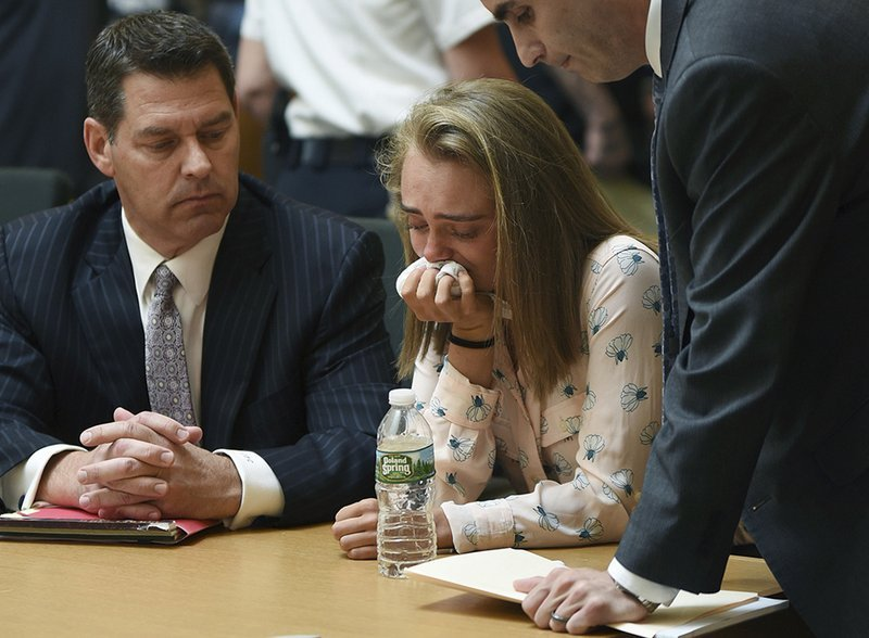 June 16, 2017 file photo of Michelle Carter, flanked by her defense attorneys, after guilty verdict was read. (Glenn C. Silva/Fairhaven Neighborhood News, Pool, File)