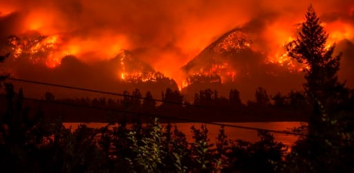 (Tristan Fortsch/KATU-TV via AP, file). FILE--This Monday, Sept. 4, 2017, file photo provided by KATU-TV shows a wildfire as seen from near Stevenson Wash., across the Columbia River, burning in the Columbia River Gorge above Cascade Locks, Ore.