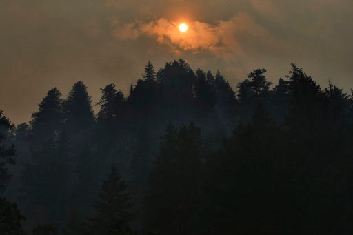 (Genna Martin/seattlepi.com via AP). Smoke clouds from the Eagle Creek Fire obscure the sun above Multnomah Falls, Wednesday, Sept 6, 2017, near Troutdale, Ore.