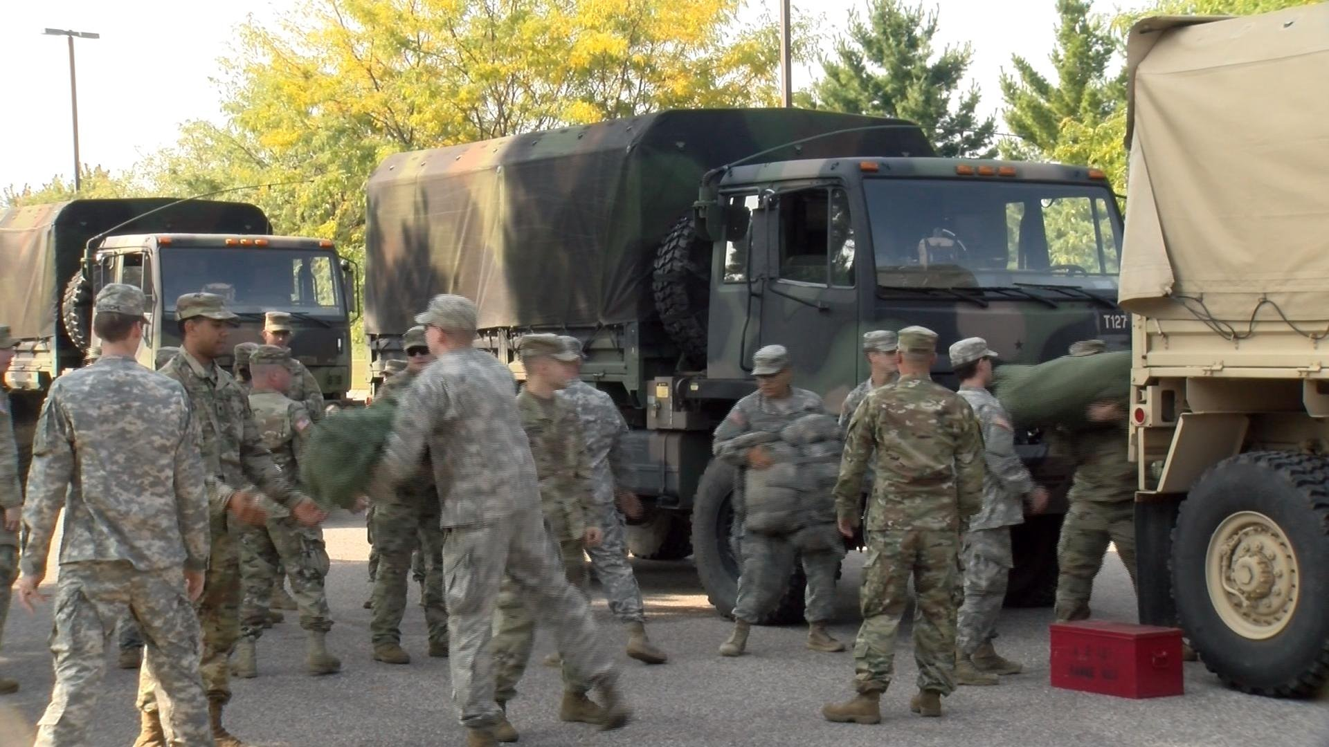 Members of the Wisconsin National Guard preparing to leave for Florida on Monday from Camp Williams