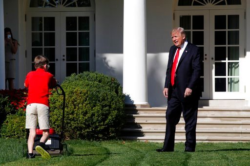 (AP Photo/Jacquelyn Martin). Frank Giaccio, 11, of Falls Church, Va., is surprised by President Donald Trump, Friday, Sept. 15, 2017, as he mows the lawn of the Rose Garden at the White House in Washington