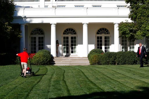 (AP Photo/Jacquelyn Martin). Frank Giaccio, 11, of Falls Church, Va., is surprised by President Donald Trump, right, Friday, Sept. 15, 2017, while mowing the lawn of the Rose Garden at the White House in Washington.