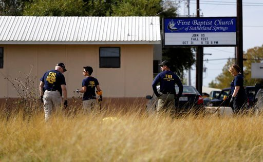 (AP Photo/Eric Gay). Law enforcement officials investigate the scene of a shooting at the First Baptist Church of Sutherland Springs, Monday, Nov. 6, 2017, in Sutherland Springs, Texas.
