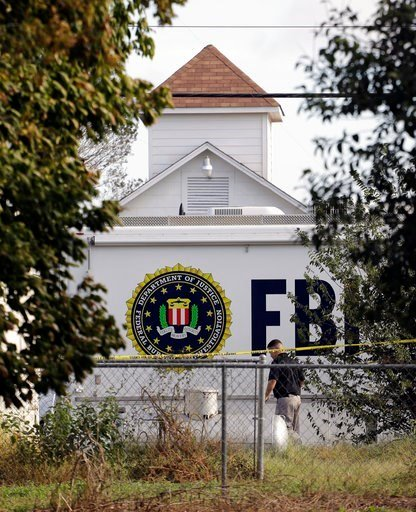 (AP Photo/Eric Gay). A law enforcement official investigates the scene of a shooting at the First Baptist Church of Sutherland Springs, Monday, Nov. 6, 2017, in Sutherland Springs, Texas