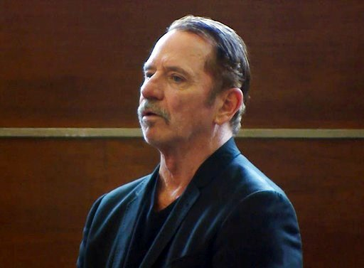 (WCVB-TV via AP, Pool, File). FILE - In this Aug. 3, 2017 still file image from video, actor Tom Wopat stands during arraignment in Waltham, Mass., on indecent assault and battery and drug possession charges.