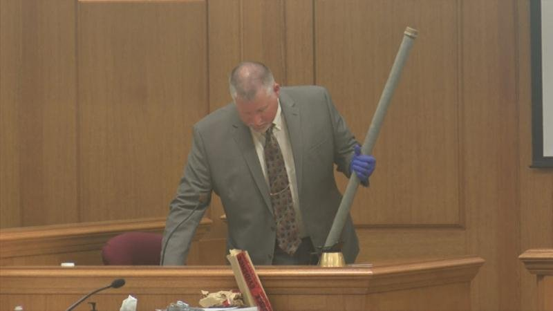 Capt. John Zimmerman of the La Crosse Co. Sheriff's Office holds the pipe that Todd Kendhammer said fell off a truck and went through the windshield of his vehicle.