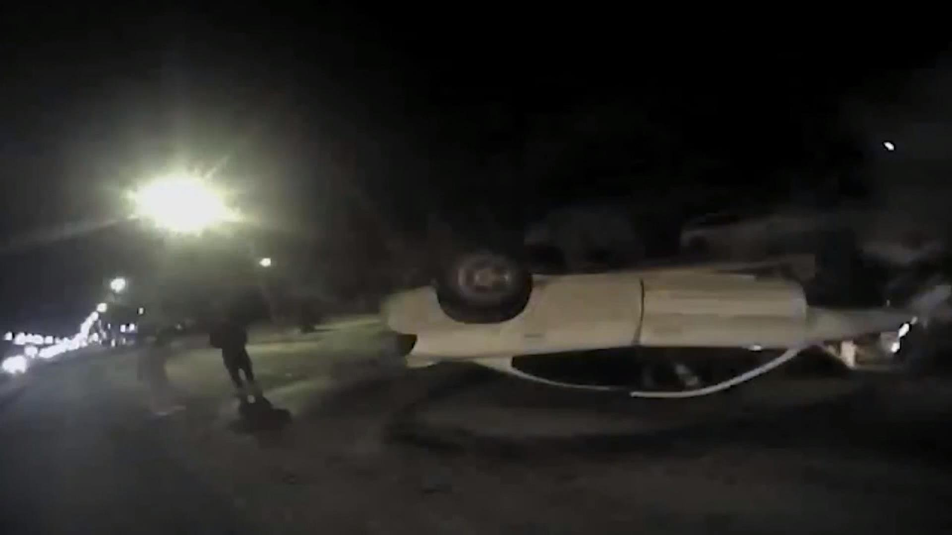 Dramatic police video captures auto crash and rescue from burning vehicle