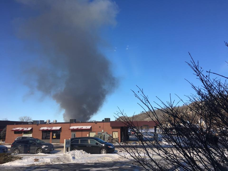 A large column of smoke comes from a fire at a group of town homes on McHugh Rd. in Holmen. Sue Brown Engstad photo