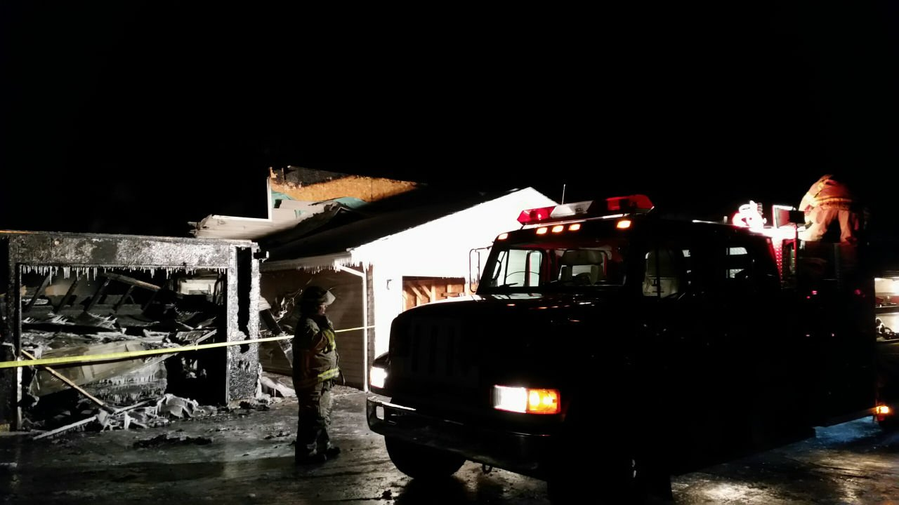 Holmen firefighters at 615 McHugh Friday evening after part of the building re-ignited.
