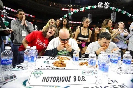 "(David Swanson/The Philadelphia Inquirer via AP, File). FILE - In this Friday, Feb. 3, 2017 file photo, Bob ""Notorious B.O.B."" Shoudt, left, takes part in the Wing Bowl in Philadelphia."