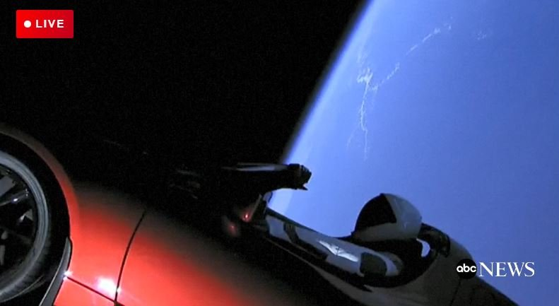 With the earth in the background, SpaceX chief Elon Musk's cherry-red Tesla Roadster in orbit after the successful launch of the Falcon Heavy rocket Tuesday.