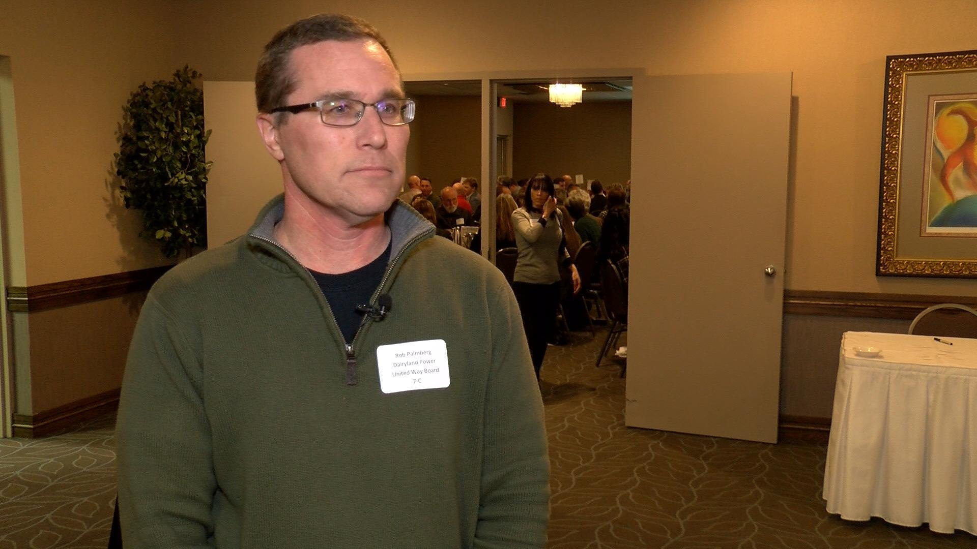 Campaign Co-Chair Rob Palmberg listens during interview.