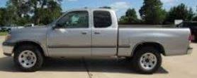 Frank may be in a silver 2002 Toyota Tundra similar to this one. The vehicle has a WI license plate of JT6762