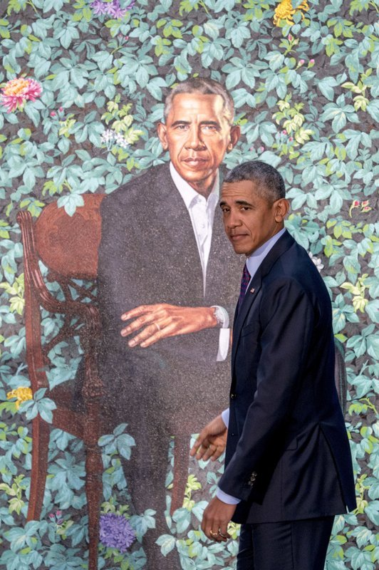 Former President Barack Obama stands in front of his official portrait by Artist Kehinde Wiley at its unveiling at the Smithsonian's National Portrait Gallery, Monday, Feb. 12, 2018, in Washington. (AP Photo/Andrew Harnik)