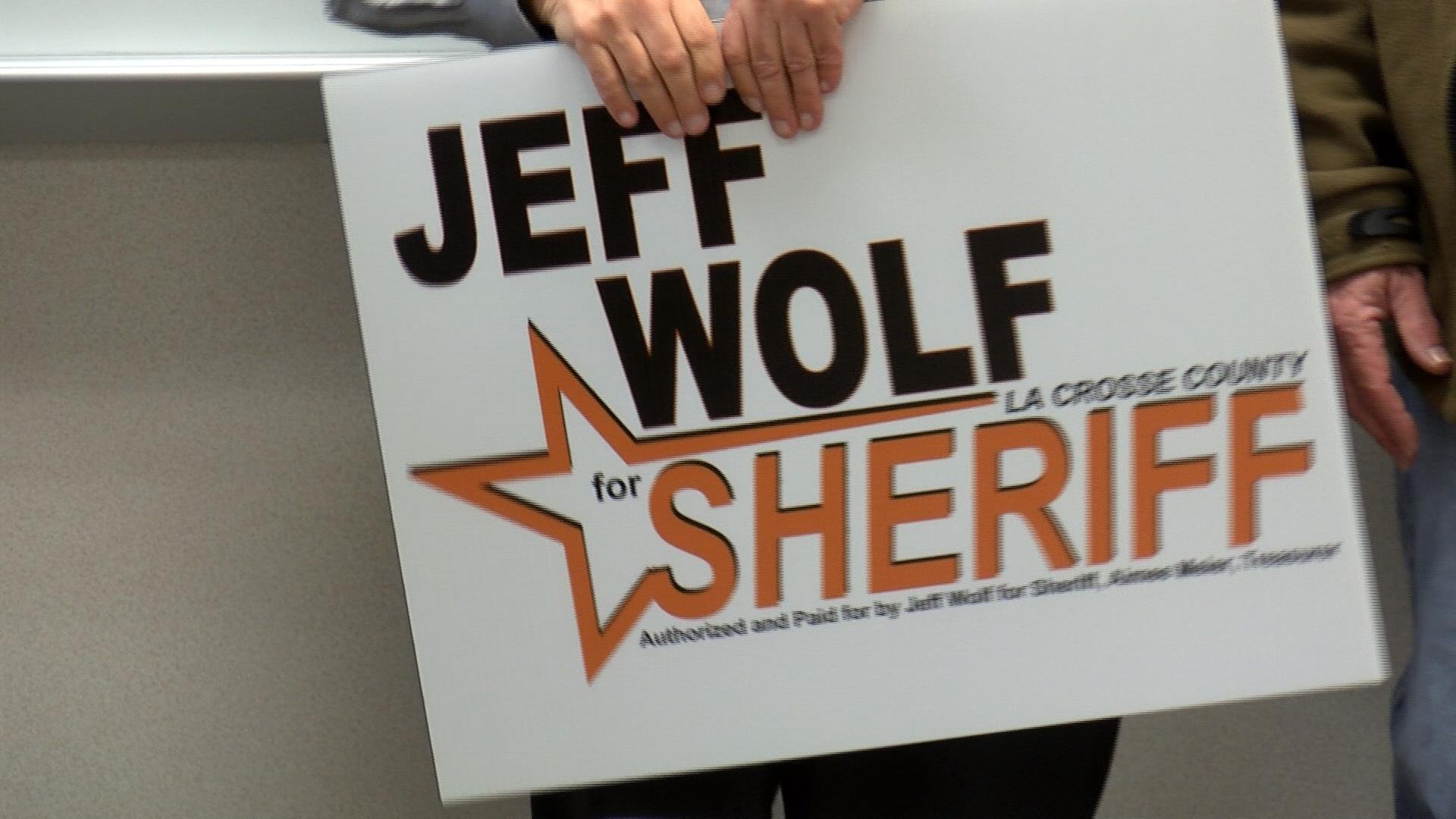 Supporter holds sign for Jeff Wolf.