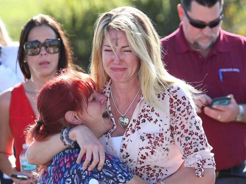 Women embrace in a waiting area for parents of students after a shooting at Marjory Stoneman Douglas High School in Parkland, Fla., Feb. 14, 2018. (AP Photo)