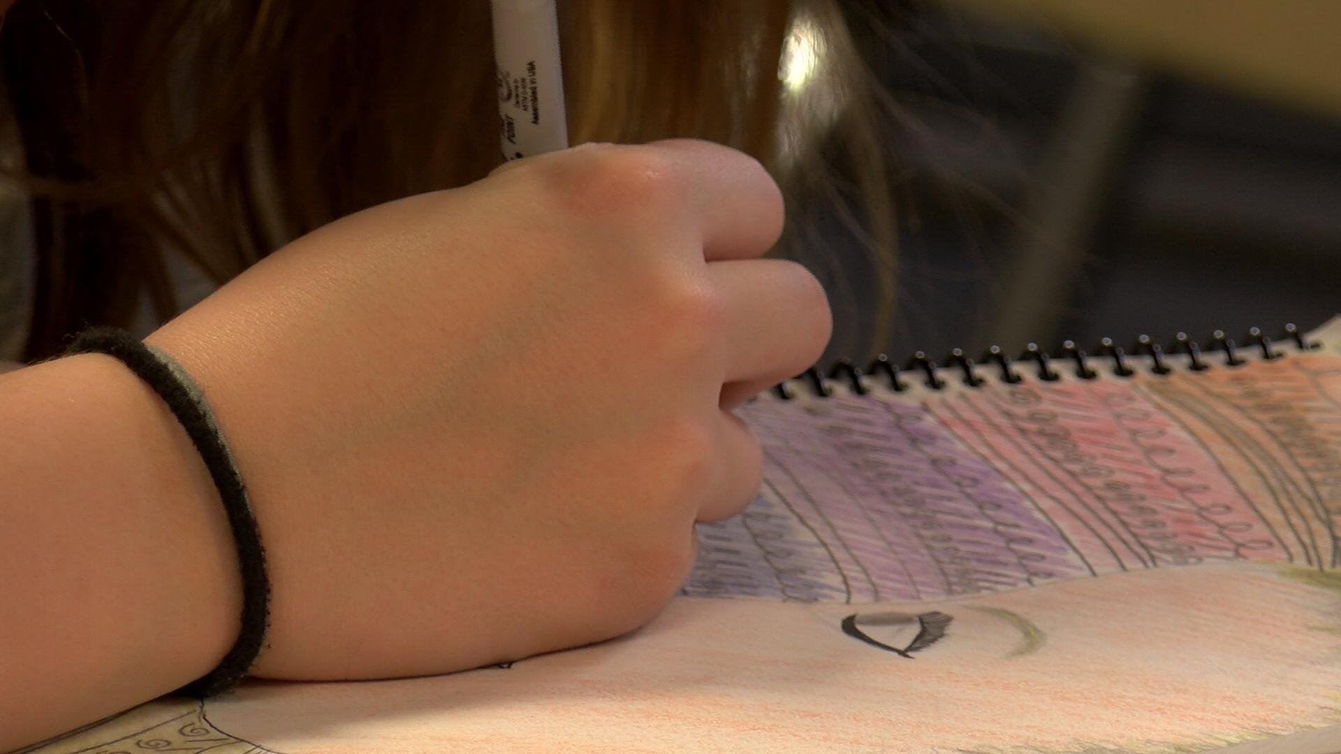 Student works on an art project at the La Crosse's Lincoln Middle School.