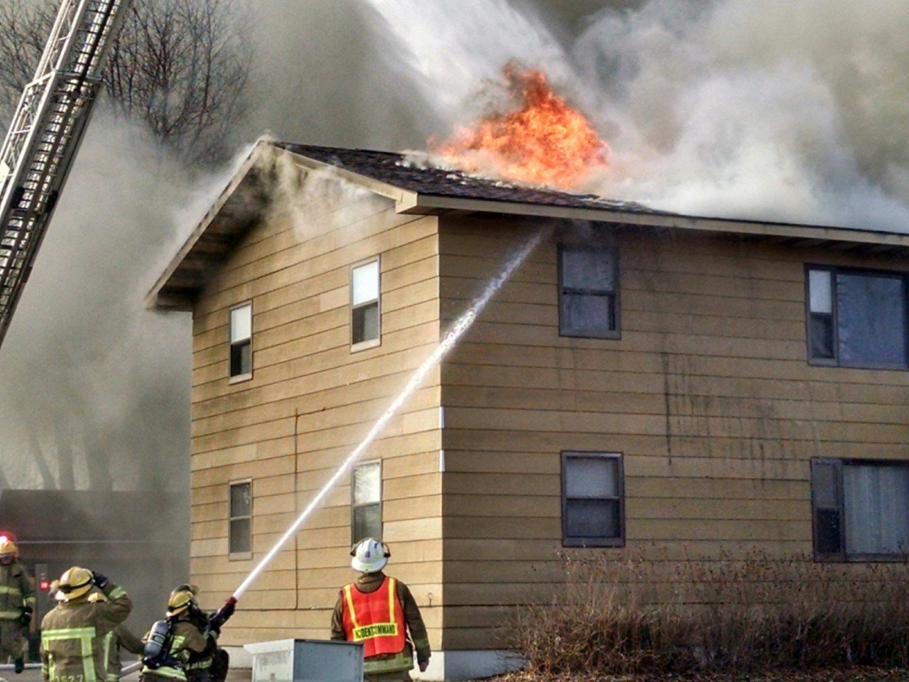 Flames coming through roof of building. Courtesy of Tomah Fire Department