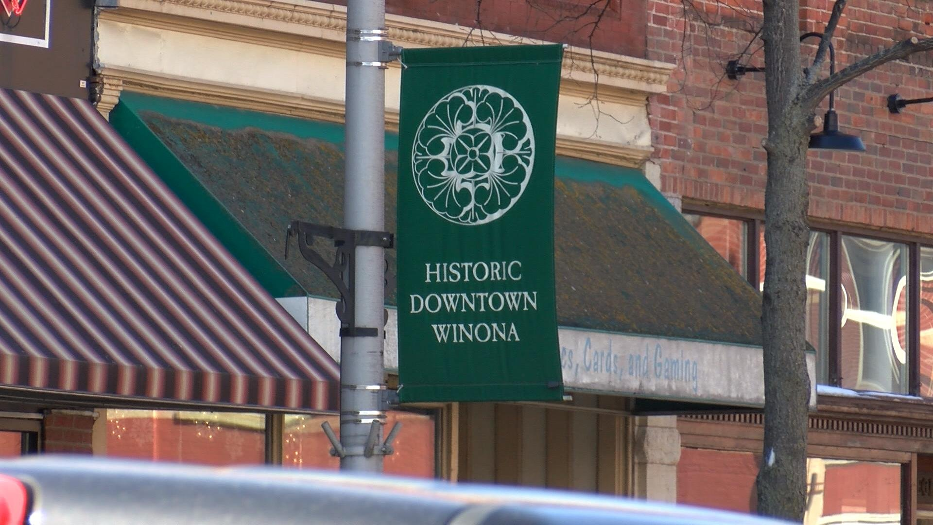 Banner hangs in downtown Winona.