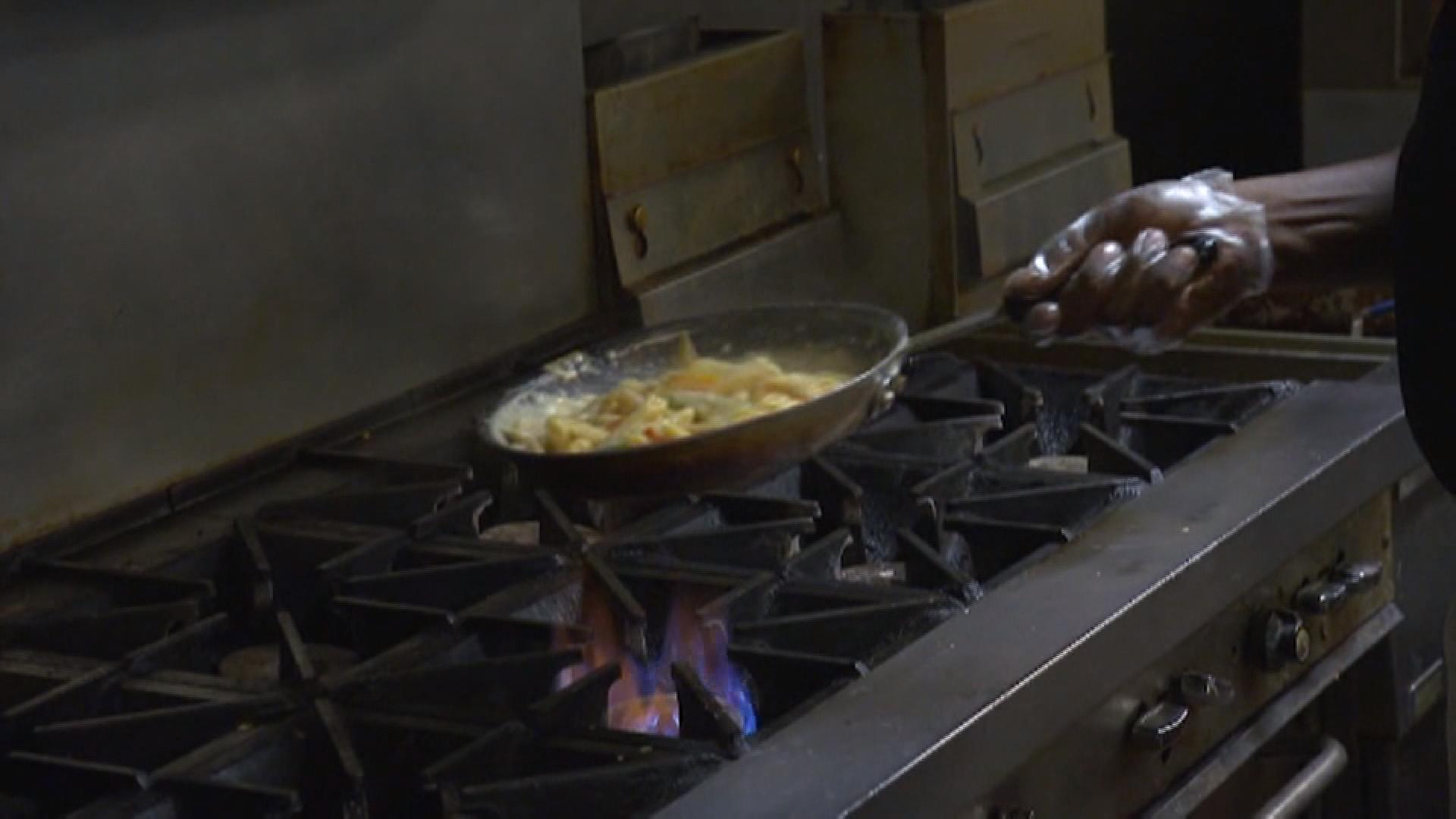 A chef prepares food.