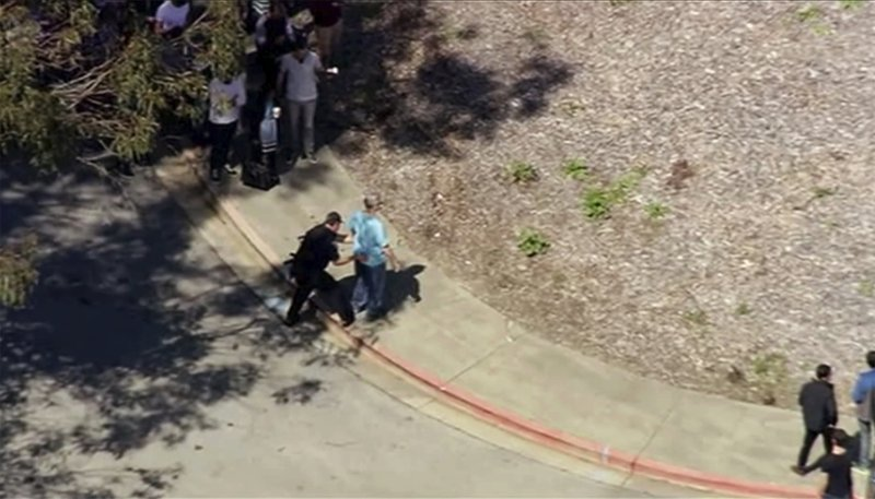 This image taken from video from KGO-TV shows a person is searched as police respond to reports of a shooting at YouTube headquarters in the city of San Bruno, Calif., on Tuesday, April 3, 2018.